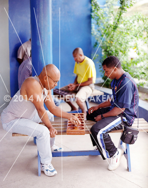 Local men play ouril int the city of Mindelo. Cape Verde, Africa.